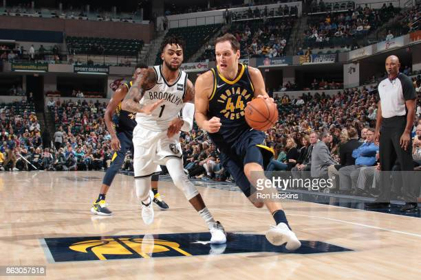 Bojan Bogdanovic of the Indiana Pacers drives to the basket against D'Angelo Russell of the Brooklyn Nets on October 18 2017 at Bankers Life...