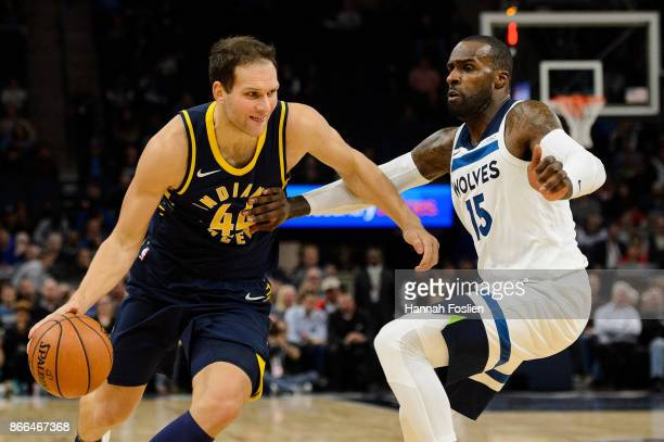 Bojan Bogdanovic of the Indiana Pacers drives to the basket against Shabazz Muhammad of the Minnesota Timberwolves during the game on October 24 2017...