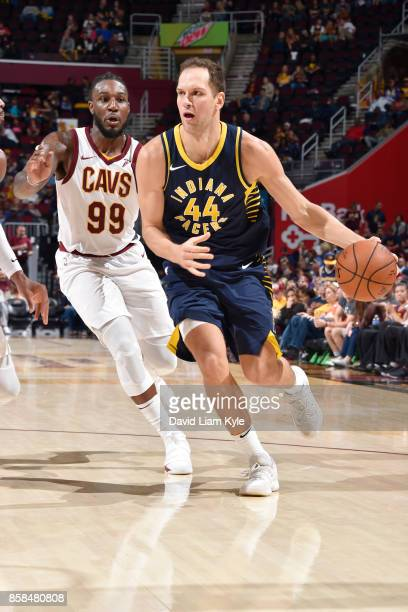 Bojan Bogdanovic of the Indiana Pacers handles the ball during the preseason game against Jae Crowder of the Cleveland Cavaliers on October 6 2017 at...