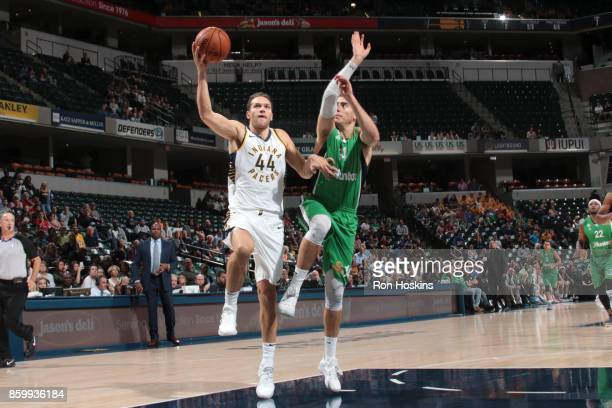 Bojan Bogdanovic of the Indiana Pacers handles the ball during the preseason game against the Maccabi Haifa on October 10 2017 at Bankers Life...