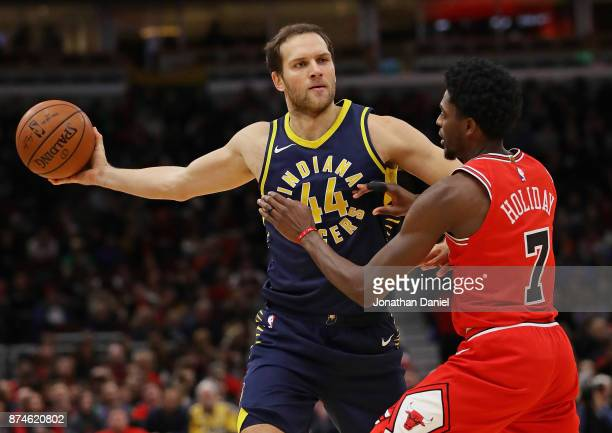 Bojan Bogdanovic of the Indiana Pacers looks to pass against Justin Holiday of the Chicago Bulls at the United Center on November 10 2017 in Chicago...
