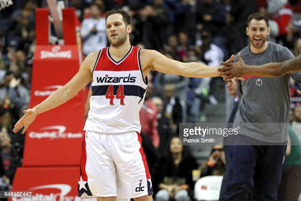 Bojan Bogdanovic of the Washington Wizards celebrates with teammates after making the gamewinning basket against the Orlando Magic during the second...