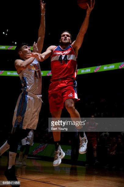 Bojan Bogdanovic of the Washington Wizards shoots a lay up against Juancho Hernangomez of the Denver Nuggets during the game on March 8 2017 at the...