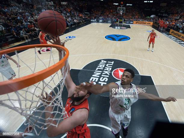 Bojan Dubljevic #14 of Valencia Basket competes with Jeff Brooks #23 of Unicaja Malaga during the 20162017 7Days Eurocup Finals Leg 3 Valencia Basket...