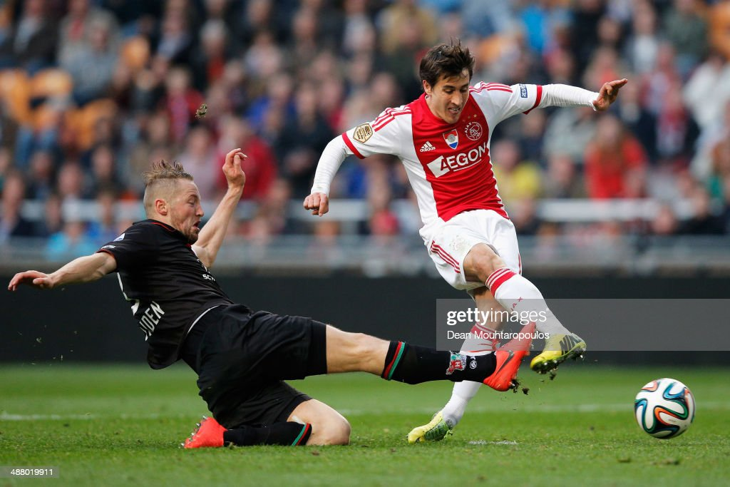 Bojan Krkic of Ajax gets past Rens Van Eijden of NEC to shoot and score his teams second goal during the Eredivisie match between Ajax Amsterdam and...