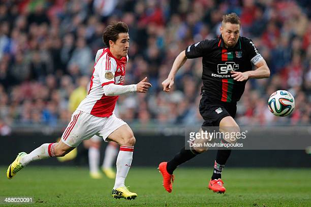 Bojan Krkic of Ajax gets past Rens Van Eijden of NEC to shoot and score his teams second goal during the Eredivisie match between Ajax Amsterdam and...