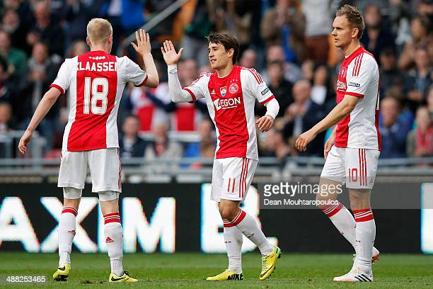Bojan Krkic of Ajax is congratulated by Davy Klaassen and Siem De Jong after he scores his teams second goal during the Eredivisie match between Ajax...