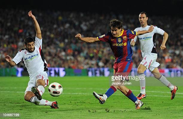 Bojan Krkic of Barcelona fails to score past Ivan Ramis of Mallorca during the La Liga match between Barcelona and Mallorca at the Camp Nou stadium...