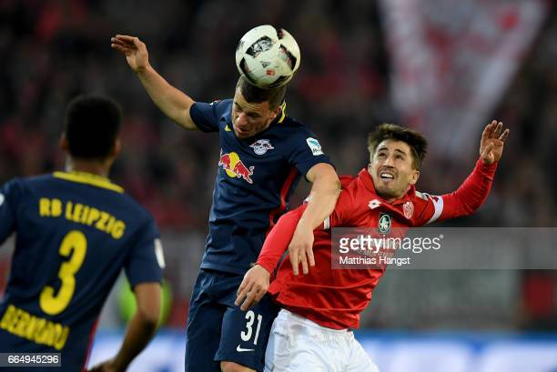 Bojan Krkic of Mainz and Diego Demme of Leipzig battle for the ball during the Bundesliga match between 1 FSV Mainz 05 and RB Leipzig at Opel Arena...
