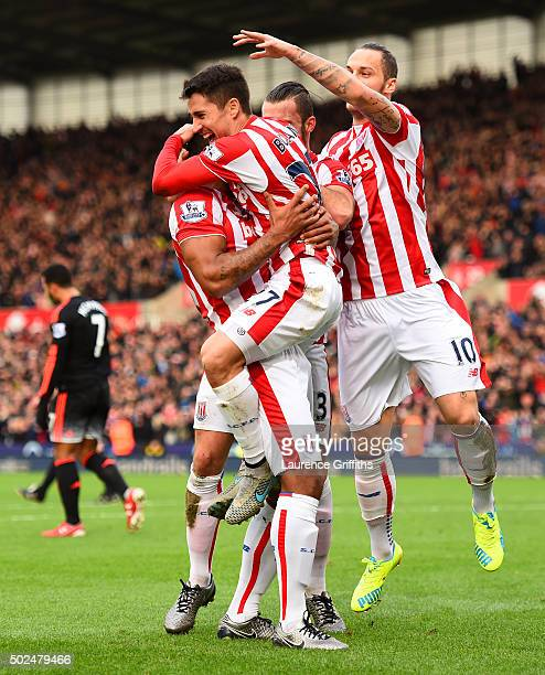 Bojan Krkic of Stoke City celebrates with teammates after scoring the opening goal during the Barclays Premier League match between Stoke City and...