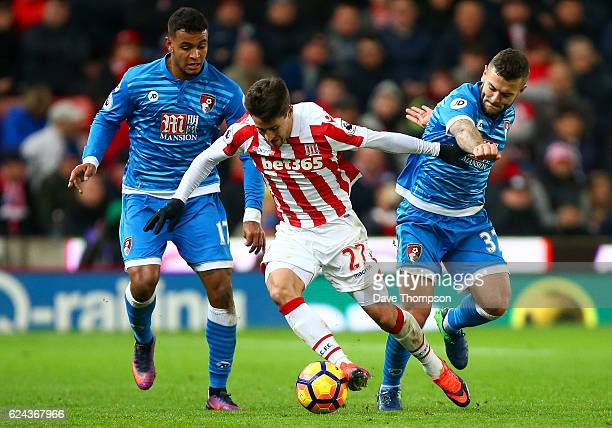 Bojan Krkic of Stoke City is put under pressure from Joshua King of AFC Bournemouth and Jack Wilshere of AFC Bournemouth during the Premier League...