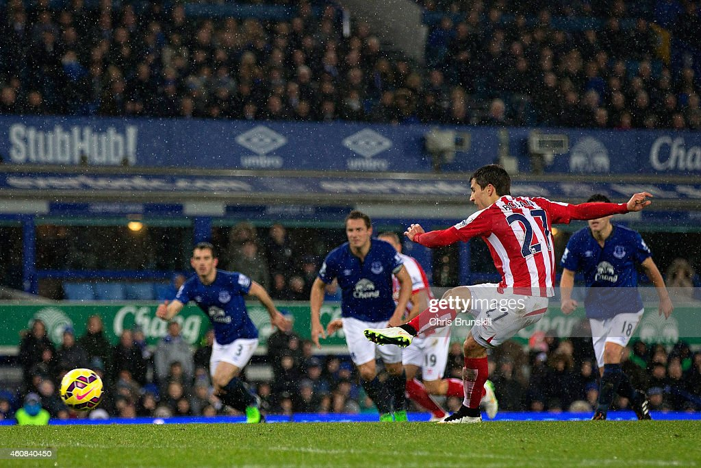 Bojan Krkic of Stoke City scores the first goal from the penalty spot during the Barclays Premier League match between Everton and Stoke City at Goodison Park on December 26, 2014 in Liverpool, England.