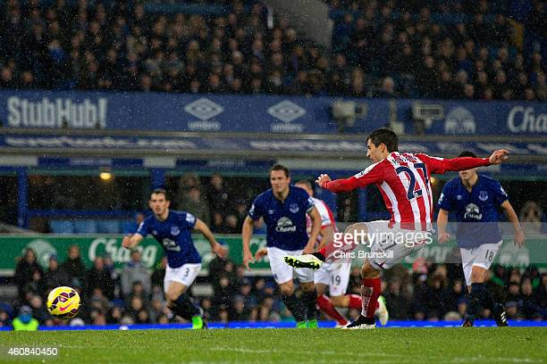 Bojan Krkic of Stoke City scores the first goal from the penalty spot during the Barclays Premier League match between Everton and Stoke City at...