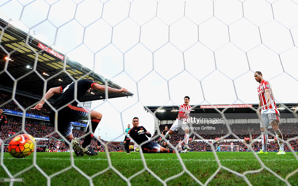 <a gi-track='captionPersonalityLinkClicked' href=/galleries/search?phrase=Bojan+Krkic&family=editorial&specificpeople=4285657 ng-click='$event.stopPropagation()'>Bojan Krkic</a> of Stoke City scores the opening goal past <a gi-track='captionPersonalityLinkClicked' href=/galleries/search?phrase=Chris+Smalling&family=editorial&specificpeople=5964313 ng-click='$event.stopPropagation()'>Chris Smalling</a> and <a gi-track='captionPersonalityLinkClicked' href=/galleries/search?phrase=Phil+Jones+-+Soccer+Player&family=editorial&specificpeople=7841291 ng-click='$event.stopPropagation()'>Phil Jones</a> of Manchester United during the Barclays Premier League match between Stoke City and Manchester United at Britannia Stadium on December 26, 2015 in Stoke on Trent, England.