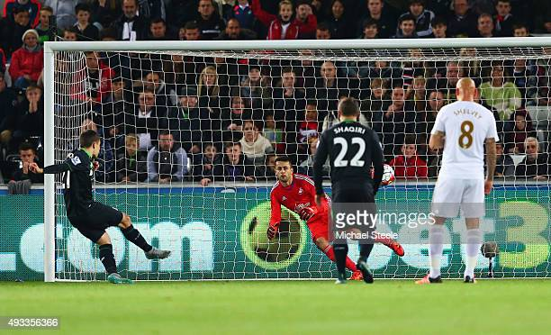 Bojan Krkic of Stoke City scores their first goal from the penalty spot past goalkeeper Lukasz Fabianski of Swansea City during the Barclays Premier...