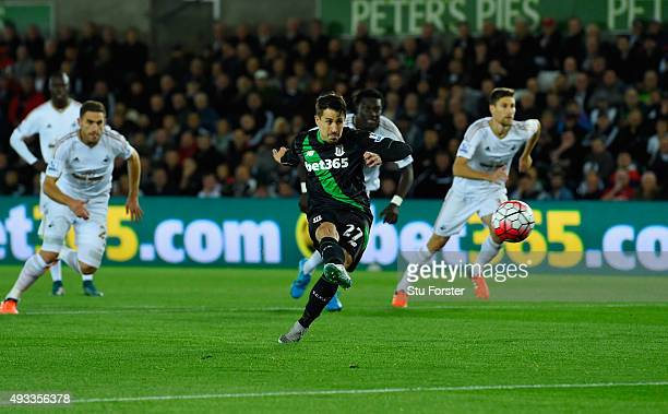 Bojan Krkic of Stoke City scores their first goal from the penalty spot during the Barclays Premier League match between Swansea City and Stoke City...