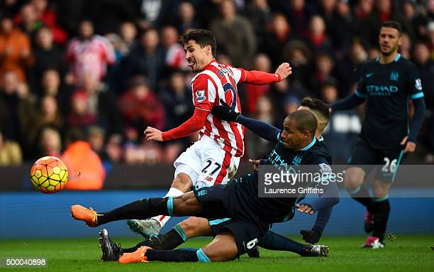 Bojan Krkic of Stoke City shoots at goal while Nicolas Otamendi and Fernando of Manchester City try to block during the Barclays Premier League match...