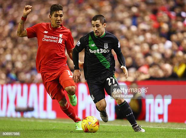 Bojan Krkic of Stoke City takes on Roberto Firmino of Liverpool during the Capital One Cup semi final second leg match between Liverpool and Stoke...