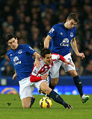 Bojan Krkic of Stoke City tangles with Gareth Barry and Seamus Coleman of Everton during the Barclays Premier League match between Everton and Stoke...