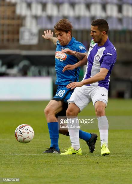 Bojan Sankovic of Ujpest FC battles for the ball with Adam Vass of MTK Budapest during the Hungarian OTP Bank Liga match between Ujpest FC and MTK...