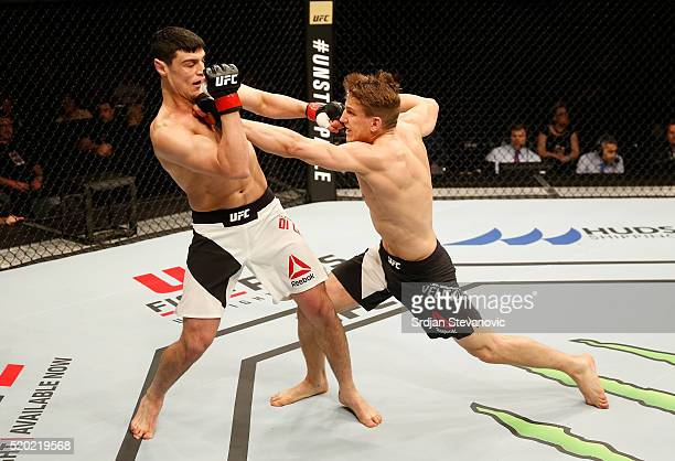Bojan Velickovic punches Alessio Di Chirico in their middleweight bout during the UFC Fight Night event at the Arena Zagreb on April 10 2016 in...