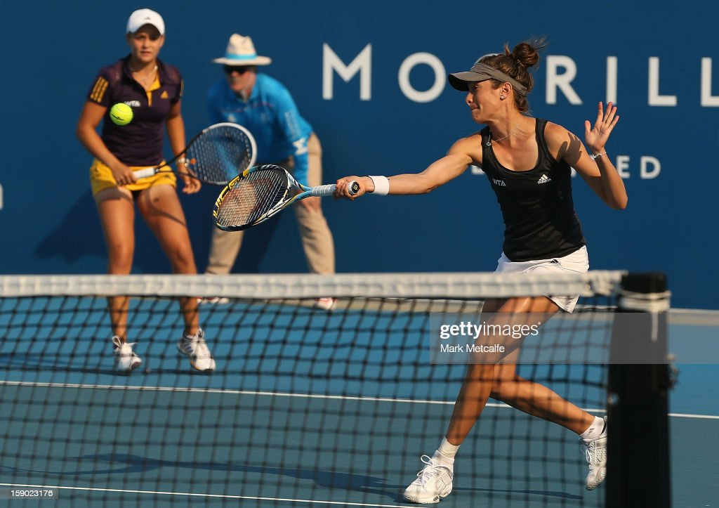 Bojana Bobusic (R) and <a gi-track='captionPersonalityLinkClicked' href=/galleries/search?phrase=Ashleigh+Barty&family=editorial&specificpeople=7369424 ng-click='$event.stopPropagation()'>Ashleigh Barty</a> of Australia (L) in action during their first round doubles match against Stephanie Bengson and Jessica Moore of Australia during day three of the Hobart International at Domain Tennis Centre on January 6, 2013 in Hobart, Australia.