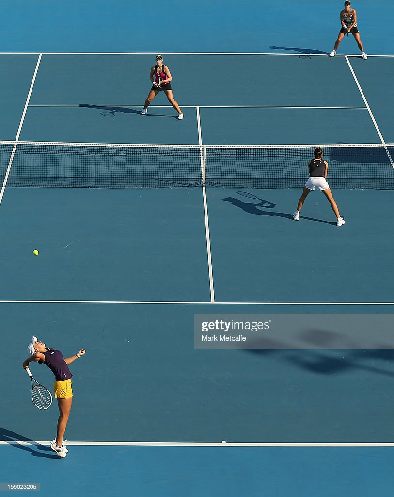 Bojana Bobusic and <a gi-track='captionPersonalityLinkClicked' href=/galleries/search?phrase=Ashleigh+Barty&family=editorial&specificpeople=7369424 ng-click='$event.stopPropagation()'>Ashleigh Barty</a> of Australia in action during their first round doubles match against Stephanie Bengson and Jessica Moore of Australia during day three of the Hobart International at Domain Tennis Centre on January 6, 2013 in Hobart, Australia.