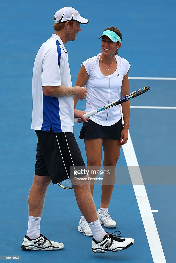 Bojana Bobusic of Australia and Chris Guccione of Australia talk tactics in their mixed doubles first round match against Anabel Medina Garrigues of Spain and Bruno Soares of Brazil during day five of the 2013 Australian Open at Melbourne Park on January 18, 2013 in Melbourne, Australia.