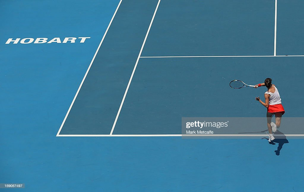 Bojana Bobusic of Australia plays a backhand in her first round match against Lauren Davis of USA during day four of the Hobart International at Domain Tennis Centre on January 7, 2013 in Hobart, Australia.