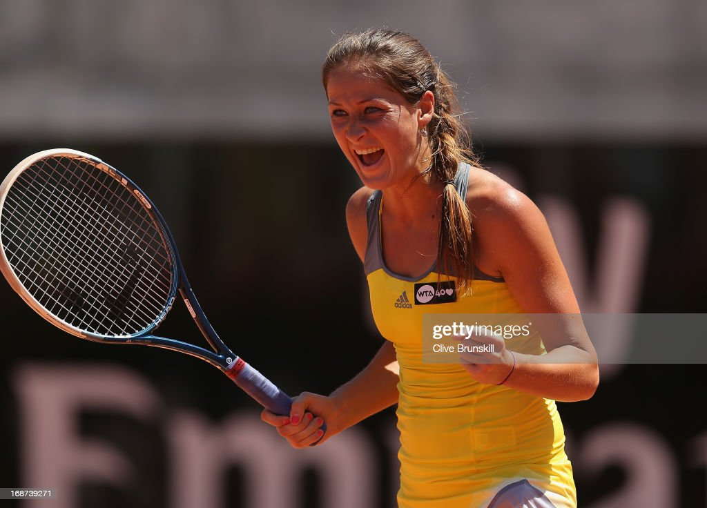 <a gi-track='captionPersonalityLinkClicked' href=/galleries/search?phrase=Bojana+Jovanovski&family=editorial&specificpeople=4836646 ng-click='$event.stopPropagation()'>Bojana Jovanovski</a> of Serbia celebrates match point against Caroline Wozniacki of Denmark in their first round match during day three of the Internazionali BNL d'Italia 2013 at the Foro Italico Tennis Centre on May 14, 2013 in Rome, Italy.