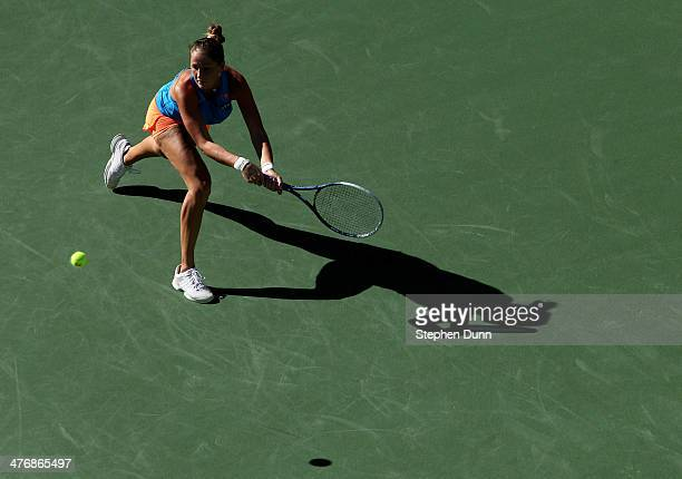 Bojana Jovanovski of Serbia hits a return to Alison Riske during the BNP Paribas Open at Indian Wells Tennis Garden on March 5 2014 in Indian Wells...