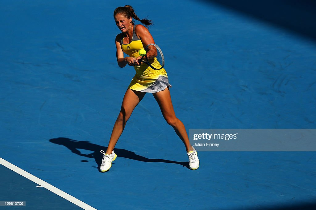 Bojana Jovanovski of Serbia plays a backhand in her fourth round match against Sloane Stephens of the United States during day eight of the 2013 Australian Open at Melbourne Park on January 21, 2013 in Melbourne, Australia.