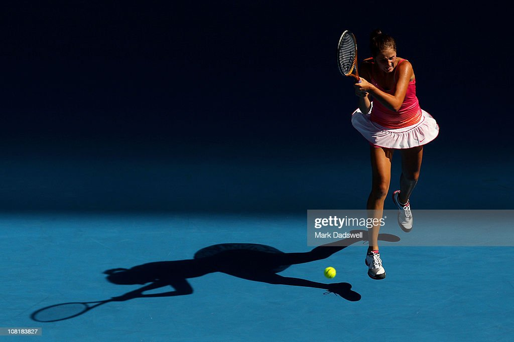 <a gi-track='captionPersonalityLinkClicked' href=/galleries/search?phrase=Bojana+Jovanovski&family=editorial&specificpeople=4836646 ng-click='$event.stopPropagation()'>Bojana Jovanovski</a> of Serbia plays a backhand in her second round match against Vera Zvonareva of Russia during day four of the 2011 Australian Open at Melbourne Park on January 20, 2011 in Melbourne, Australia.
