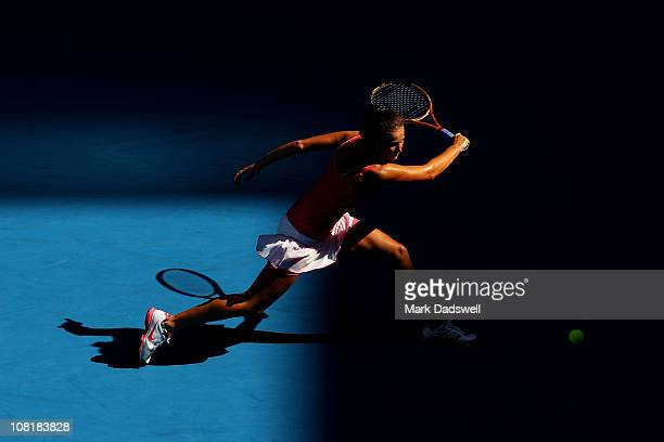 Bojana Jovanovski of Serbia plays a backhand in her second round match against Vera Zvonareva of Russia during day four of the 2011 Australian Open...