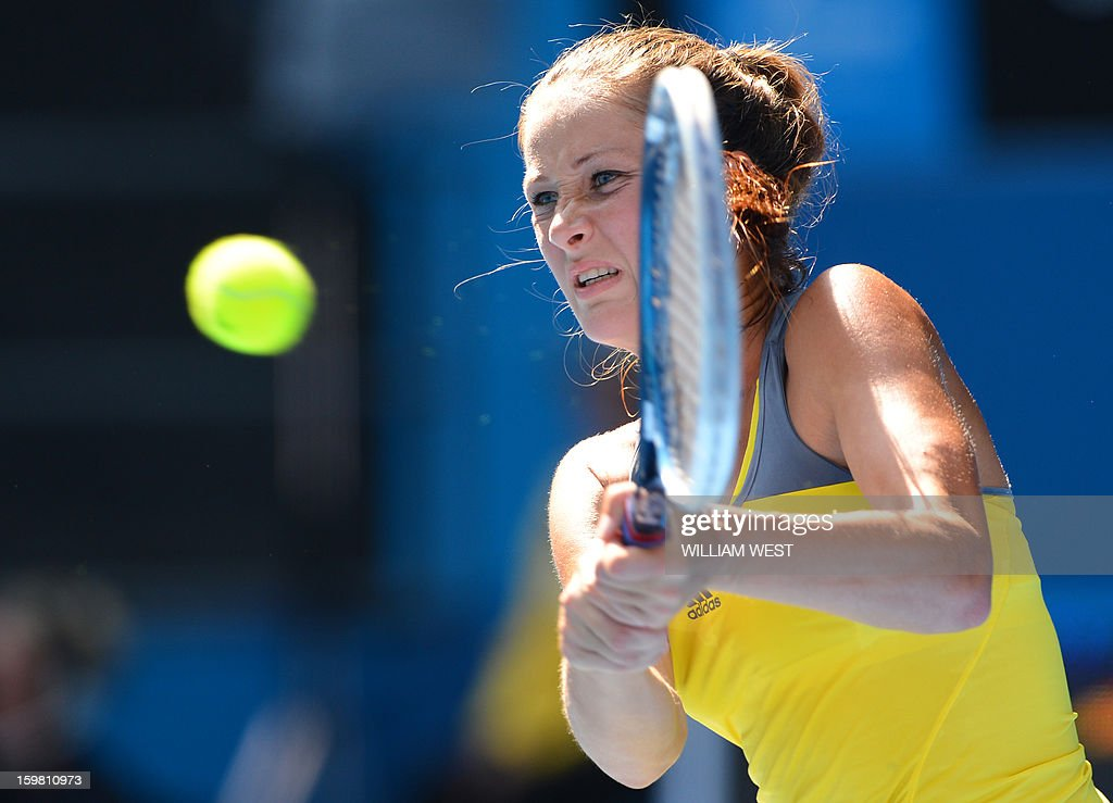 Bojana Jovanovski of Serbia plays a return during her women's singles match against Sloane Stephens of the US on the eighth day of the Australian Open tennis tournament in Melbourne on January 21, 2013.