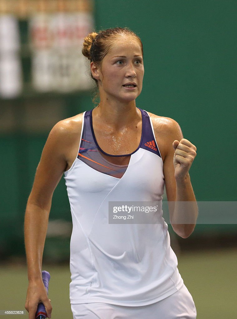 <a gi-track='captionPersonalityLinkClicked' href=/galleries/search?phrase=Bojana+Jovanovski&family=editorial&specificpeople=4836646 ng-click='$event.stopPropagation()'>Bojana Jovanovski</a> of Serbia reacts during her match against Monica Niculescu of Romania during day two of the 2014 WTA Guangzhou Open at Tianhe Sports Center on September 16, 2014 in Guangzhou, China.