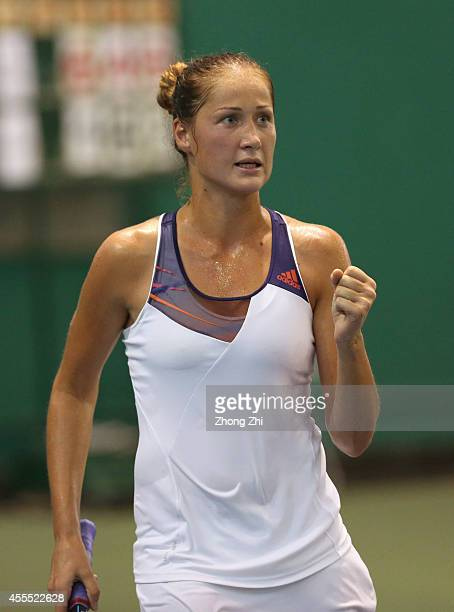 Bojana Jovanovski of Serbia reacts during her match against Monica Niculescu of Romania during day two of the 2014 WTA Guangzhou Open at Tianhe...