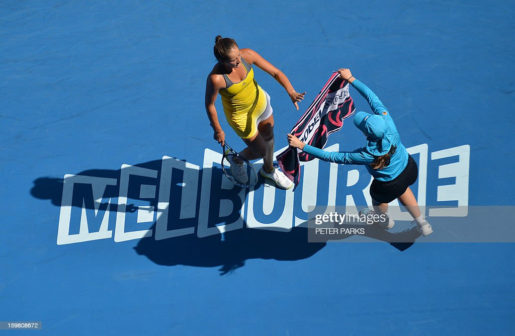 Bojana Jovanovski of Serbia(C) receives her towel from a ballboy during her women's singles match against Sloane Stephens of the US on the eighth day of the Australian Open tennis tournament in Melbourne on January 21, 2013.