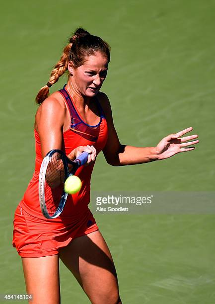 Bojana Jovanovski of Serbia returns a shot against Jelena Jankovic of Serbia during her women's singles first round match on Day One of the 2014 US...