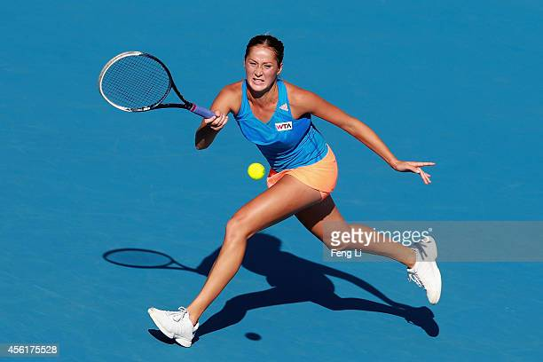 Bojana Jovanovski of Serbia returns a shot against Romina Oprandi of Switzerland during day one of the China Open at the China National Tennis Center...
