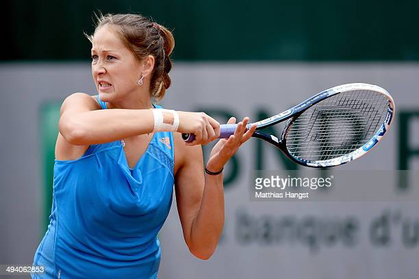 Bojana Jovanovski of Serbia returns a shot during her women's singles match against Camila Giorgi of Italy on day three of the French Open at Roland...