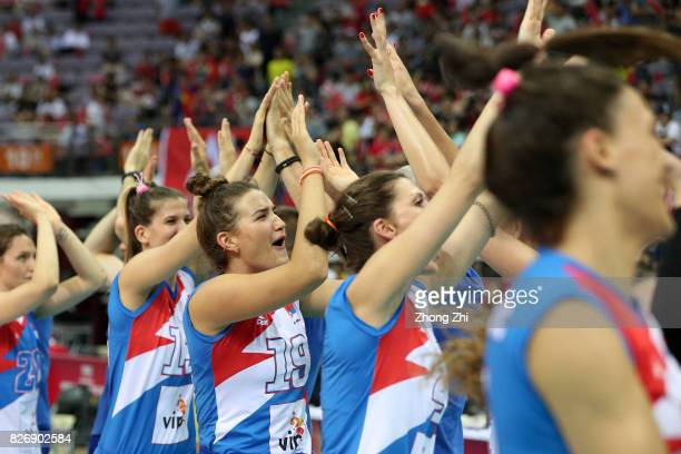 Bojana Milenkovic and team mates of Serbia celebrate winning the match between China and Serbia during 2017 Nanjing FIVB World Grand Prix Finals on...