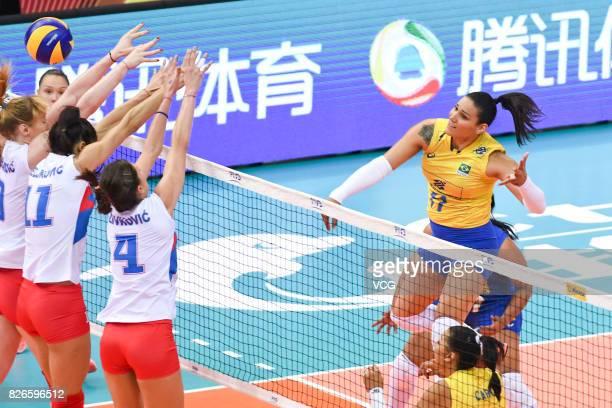 Bojana Zivkovic of Serbia and Stefana Veljkovic of Serbia block the ball during the semifinal match of 2017 Nanjing FIVB World Grand Prix Finals...