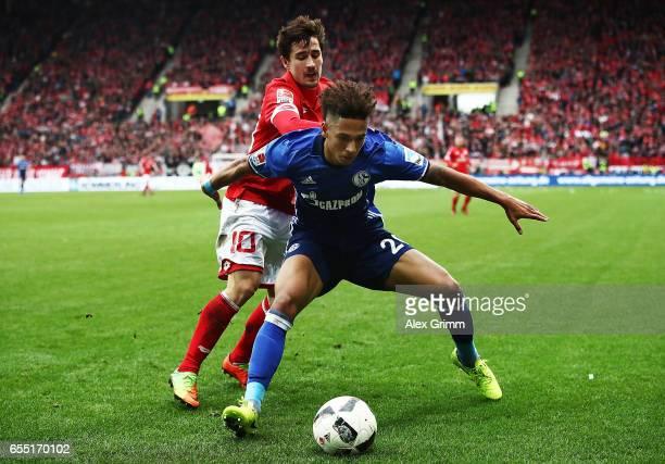 B BojanKrkic Perez of FSV Mainz 05 challenges Thilo Kehrer of Schalke 04 during the Bundesliga match between 1 FSV Mainz 05 and FC Schalke 04 at Opel...