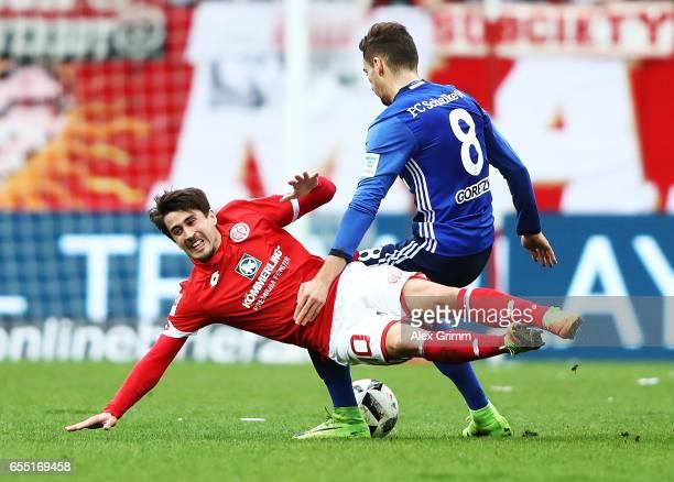 B BojanKrkic Perez of FSV Mainz 05 is challenged by Leon Goretzka of Schalke 04 during the Bundesliga match between 1 FSV Mainz 05 and FC Schalke 04...