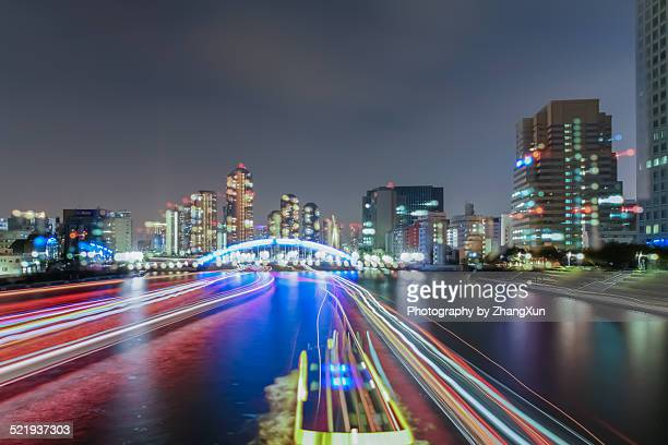 Bokeh image of Tokyo city illuminated over river