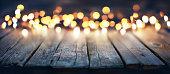 blurred lights on old wood