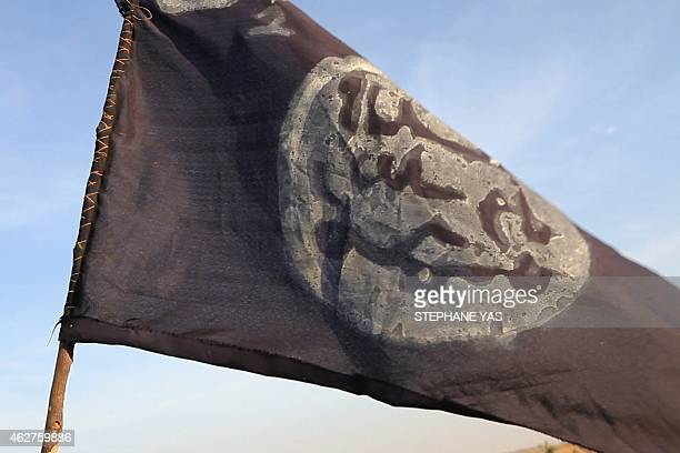 A Boko Haram flag flutters from an abandoned command post in Gamboru deserted after Chadian troops chased them from the border town on February 4...