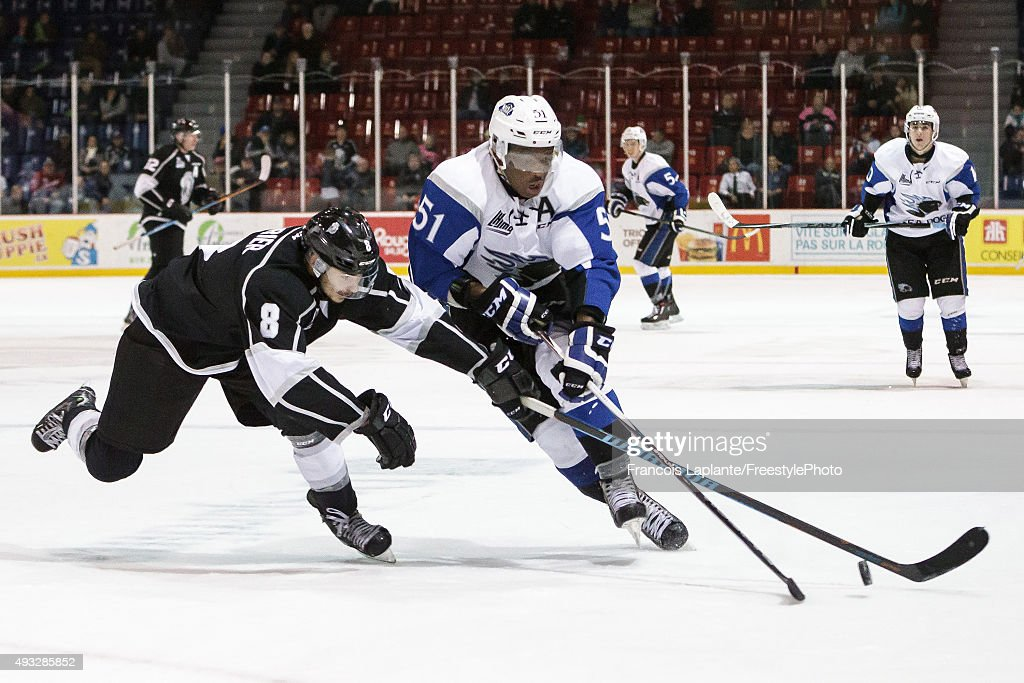 Bokondji Imama #51 of the Saint John Sea Dogs controls the puck against Alexandre Carrier #8 of the Gatineau Olympiques on October 18, 2015 at Robert Guertin Arena in Gatineau, Quebec, Canada.
