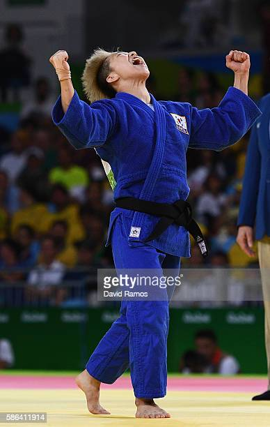 Bokyeong Jeong of Republic of Korea celebrates after defeating Urantsetseg Munkhbat of Mongolia in the Women's 48 kg Judo on Day 1 of the Rio 2016...